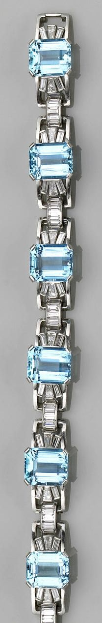 An aquamarine, diamond and platinum bracelet, circa 1950 designed as six openwork panels each centering a rectangular-cut aquamarine and flanked by baguette-cut diamond three-stone sprays, completed by baguette-cut diamond arched spacers; estimated total aquamarine weight: 39.00 carats; estimated total diamond weight: 4.30 carats