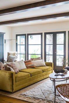 Love the jolt of color this velvet sofa gives the rustic living room.