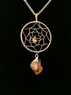 Beautiful Dream catcher pendants wire wrapped with a polished matching gemstone in the center. Dangling from the bottom are small gold dipped