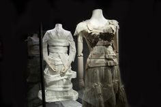 From left to right: Comme des Garçons by Rei Kawakubo spring/summer 2012 blouse and skirt in tetron lace and silk satin rayon, worn with a birdcage skirt and corset in nylon tricot.