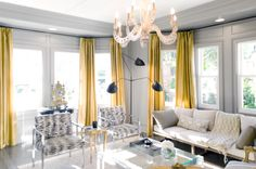 gold curtains against gray walls - by Lukas Machnik
