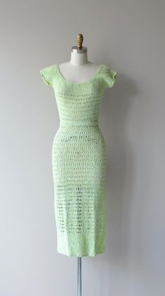 Vintage 1930s green apple green woven knit dress with wide neckline, short sleeves and matching belt. This dress is see-through and a slip is