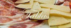 Pluralidad de tablas con productos de calidad y prestigio en Ruta al Sur. Incluye todo tipo de productos frescos, curados e ibéricos.