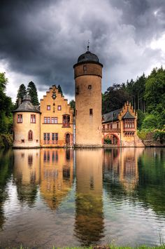 Mespelbrunn Castle is a medieval moated castle on the territory of the town of Mespelbrunn, between Frankfurt and Würzburg, built in a remote tributary valley of the Elsava valley, within the Spessart forest.