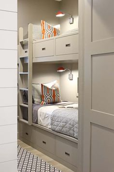 Contemporary boys' bedroom features gray walls lined with gray built-in bunk beds fitted with drawers dressed in orange and gray bedding illuminated by industrial orange sconces finished with a gray ladder alongside a gray geometric rug. Bunk Bed Rooms, Bunk Beds Built In, Bunk Beds With Storage, Modern Bunk Beds, Bunk Beds With Stairs, Kids Bunk Beds, Bunk Beds With Drawers, Bunk Bed Ideas For Small Rooms, Contemporary Bunk Beds