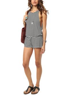 Loving this airy black and white striped romper paired with sandals for an easy ensemble that is perfect for hitting the beach.