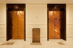 Elevator doors shown in Fused Bronze with Mirror finish and ECO205H Eco-Etch pattern at the Stanford Court Renaissance Hotel, San Francisco, California