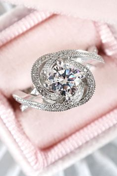 This exquisite engagement ring features a roundStar 129diamond prong set in the center of a swirling halo of bright cut set diamonds, with additional diamond and milgrain accents on the split, criss-cross shank. Designed and created by Joseph Jewelry | Seattle, WA | Bellevue, WA | Online | Design Your Own Engagement Ring | #engagementring