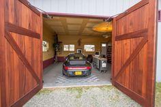 Pictures of Carriage House & Garage Doors | Real Carriage Doors Carriage House Garage Doors, Wooden Garage Doors, Carriage Doors, Garage Door Design, Winchester, Garage Pictures, Farm Shed, Garage Door Makeover, Door Picture