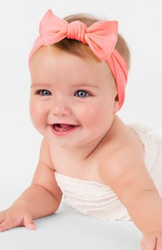 Gushing over this pretty in pink baby girls' headband. It's the perfect accessory when you just can't quite get their hair in a pony tail.