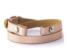Metallic rose gold wrap bracelet...what a classy look. Elevate this style by adding a a pair of sparkly earrings.