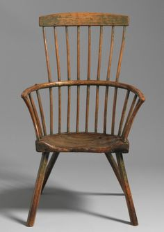 Primitive comb back Windsor armchair, ash, elm and walnut with traces of green paint, English, circa 1760