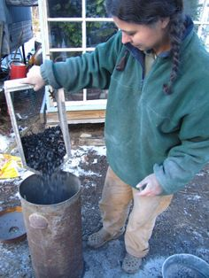 DIY Charcoal sifter, collecting charcoal from wood stove ashes. | http://www.waldeneffect.org/blog/Wood_stove_biochar_experiment/