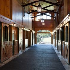 Love my barn ! Love the combination of wood, brick, iron and beams in this horse barn. It's nice that the stall doors have openings for the horses to stick their heads out. Dream Stables, Dream Barn, My Dream Home, Dream Life, Equestrian Stables, Horse Barn Designs, Horse Property, Horse Stalls, Barn Stalls