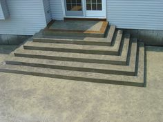 Stamped concrete grand staircase with acid stained border. Stamped Concrete Driveway, Concrete Porch, Driveway Paving, Concrete Stairs, Concrete Driveways, Patio Steps, Patio Construction Ideas, Cobblestone Walkway, Porch Stairs