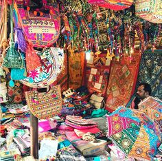 Sensory overload! This is one of the many markets in Delhi selling traditional fabric, scarves and accessories. A technicolor dream! #incredibleindia #market #bazaar #handmade #colorful #colors #travel #wanderlust #purse #clothing #design #urban #scarf