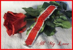 Hey, I found this really awesome Etsy listing at https://www.etsy.com/listing/275747284/red-cuff-bracelet-red-flat-beaded