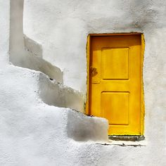 Yellow door in Santorini by taty-A-na on flickr