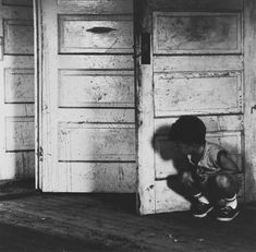 Ralph Eugene Meatyard • Boy at a Door
