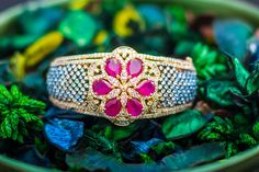Inspired by the large jewelry of the Victorian age. Fuchsia and diamond colored stones engulfed 18k gold electroplating. Available at   http://www.gvccustomgold.com