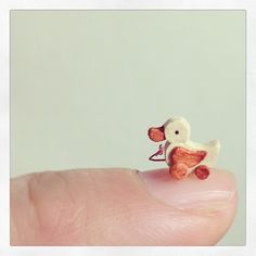 "Now here's something that'll make you go ooh, ahh, and aww! Japanese miniaturist Tomo Tanaka, who goes by his alias ""Nunu's House,"" creates mind-bogglingly amazing artwork...that's smaller than a fingernail!"