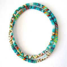 This stunning necklace was made by Cherokee sisters Monā & Precise Lossie using the intricate peyote stitch technique in vibrant tribal patterns.