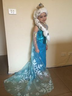 A Queen Elsa costume I made for my 5 year old daughters birthday. No pattern, sorry, I winged it, and you can see I forgot to do sleeves and had to add them in as gloves. The gorgeous snowflake fabric was in Etsy. I made the yarn wig based loosely on some 'Tangled' yarn wig tutorials (on Pinterest). The tiara was from a tutorial in 'Instructables'. She had a great day, it was well worth the effort :)