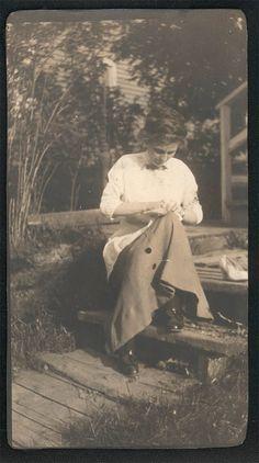 vintage photo Woman Sews Mending on Porch
