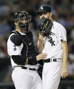 Chicago White Sox catcher A.J. Pierzynski talks with starting pitcher Chris Sale during the seventh inning of a baseball game against the New York Yankees, Wednesday, Aug. 22, 2012, in Chicago. (AP Photo/Charles Rex Arbogast)