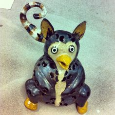 A lemur and a penguin mixed. Made completely hollow out if gray clay