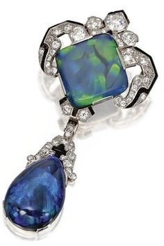 Platinum, gold, black opal, diamond and onyx pendant/brooch, Cartier, Paris c. 1920 #opalsaustralia