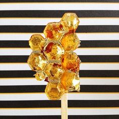 Honey and rose lollipop with rose petals and 23k gold leaf. #chowtastic #lollipop #humiditysucks