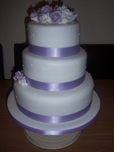 3 tier wedding cake with lilac and white flowers By kirsty00000 on CakeCentral.com