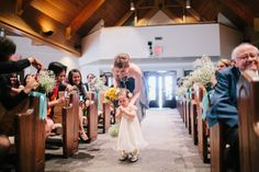 Baby's breath for pews with robin's egg ribbon and baby's breath pomander for flower girl.  Clarence Chan Photography