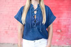 Denim cross tie top is perfect for the fall. Pair it with jeans or a leather skirt.