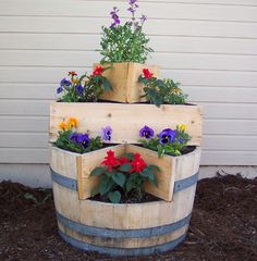 Old wine barrels make a charming option for your raised bed.