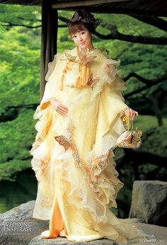 Traditional Japanese kimono given a modern twist with lighter fabrics and use of ruffles and animal print - The new romantic traditional wedding dress -- Colorful Wedding Kimono from Scena D'uno 2010 Kimono Chino, Traditioneller Kimono, Mode Kimono, Traditional Wedding Dresses, Traditional Outfits, Japanese Wedding Kimono, Traditional Japanese Kimono, Mellow Yellow, Kimono Fashion