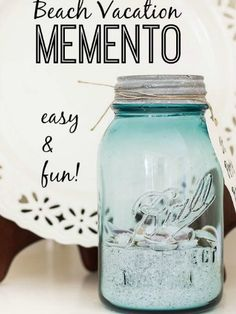 A blue-tinted mason jar mimics the ocean and sweetly displays sand and shells picked up at the shoreline.
