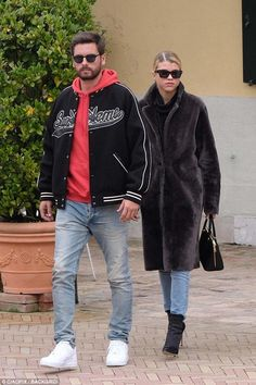 Sofia Richie wearing Celine Cl41468 Edge Sunglasses, Gianvito Rossi Arles Boots, Prada Promenade Bag and Joseph Oversized Coat