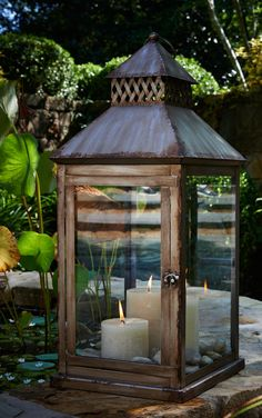 Add timeless candle light and elegance to your space.   A beautiful lantern with a hand painted finish can add the perfect touch to your patio, garden, pool side, or even indoors on a rustic table. The ring at the top allows you to hang the lantern if desired. The single door opens so it is easy to place and light a candle of your choice inside. #lantern #candlelight #outdoors