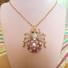 Pink and clear crystal spider necklace Spider necklace on gold color chain. Pink and clear crystals. Has Betsey Johnson heart charm by clasp but unsure if authentic. Betsey Johnson Jewelry Necklaces