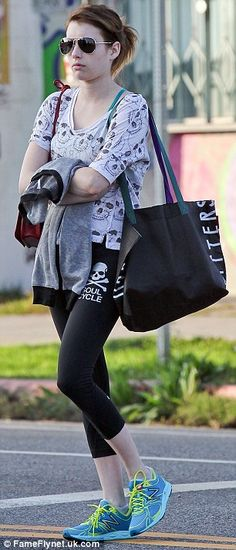 Gym bunny: Emma seemed to be heading for a workout in her casual ensemble of a printed T-shirt, leggings and bright aqua trainers