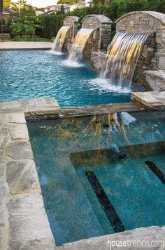 Water features provide extra sparkle to a swimming pool's design. @housetrends