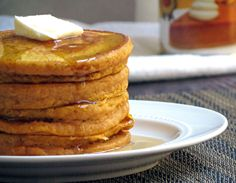 Fluffy pumpkin pancakes with cozy autumn spices. Mmm!