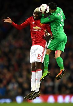 Paul Pogba of Manchester United and Vincent Pajot of SaintEtienne in action during the UEFA Europa League Round of 32 first leg match between...