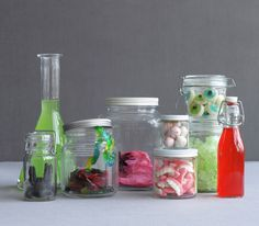 Assorted glass jars filled with gummy worms, eyeballs and other candies for mad scientist's specimen jars