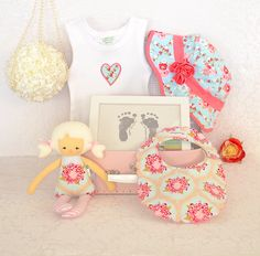 Beautiful hamper with vintage inspired bib and doll available online.