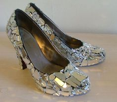 I'm surprised I haven't seen this lying around the Drag Race sets.  DIY fashion: cracked mirror shoes