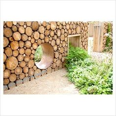 Cool Fences for Your Yard and Garden log wall- I wonder how well it would age. Would it quickly become a rotting pile of debris? How would you seal it? - Another!