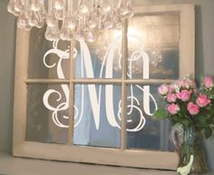 Can't think of a better way to use an old wood window than to turn it into a vintage mirror and apply a vinyl monogram!